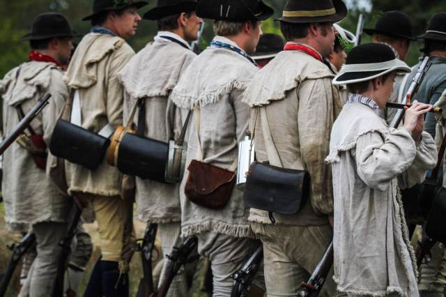 The recreated Grenadiers at the position of 'Trail Arms' during the October, 2013 reenactment. This reconstruction was based on extensive research by Andrew De Lisle and Paul Zelesnikar of the Colonial Williamsburg Foundation and Neal Hurst of the Museum of the American Revolution. (Courtesy of Drifting Focus Photography. http://photography.driftingfocus.com/)