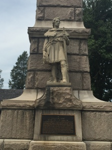 A detail of the frontiersman depicted on the obelisk.
